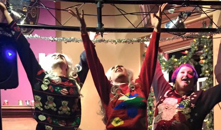 Aphrodisiac, Mimi, and Tyffanie closing out a drag routine.